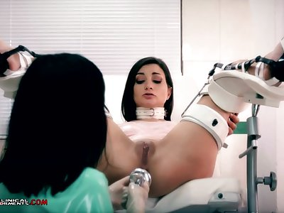 Crazy nurse, Minerva is toying connected with Valentina Bianco, while they are unattended in the slot
